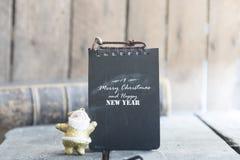 Tarjeta de la Feliz Navidad y de la Feliz Año Nuevo Imagenes de archivo