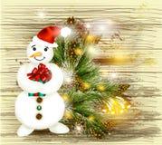 Tarjeta de la Navidad del saludo y del Año Nuevo con el muñeco de nieve que sostiene el regalo o Fotos de archivo