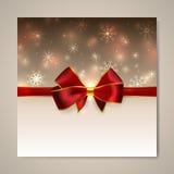 Tarjeta de la Navidad y del Año Nuevo con el arco Fotos de archivo libres de regalías