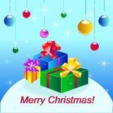 Tarjeta de la Navidad y del Año Nuevo con las bolas y los presentes Foto de archivo