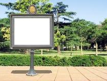 Tarjeta de la publicidad en un parque Imágenes de archivo libres de regalías