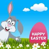 Tarjeta de la sonrisa y de felicitación del conejo de Pascua Foto de archivo