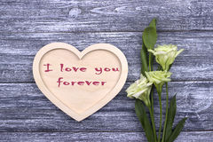 Tarjeta de la tarjeta del día de San Valentín con el texto te amo para siempre Foto de archivo libre de regalías