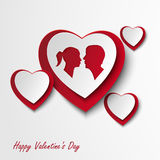Tarjeta de la tarjeta del día de San Valentín con los corazones y los amantes Foto de archivo libre de regalías