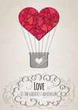 Tarjeta de la tarjeta del día de San Valentín con un globo en forma de corazón del aire caliente y un lema del amor Fotografía de archivo libre de regalías
