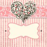 Tarjeta de la vendimia con el corazón abstracto Imagen de archivo