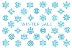 Tarjeta de la venta del invierno con los cristales de la nieve ilustración del vector
