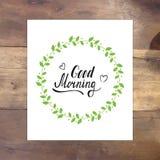 Tarjeta de letras del vector de la buena mañana con la rama del laurel Imagenes de archivo