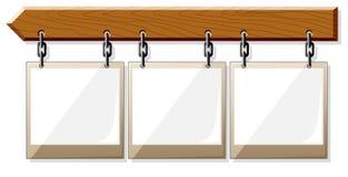 Tarjeta de madera con los marcos vacíos Foto de archivo