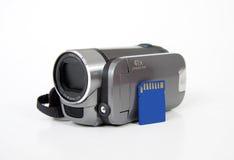 Tarjeta de memoria del Sd con la cámara casera handheld digital Imagen de archivo libre de regalías