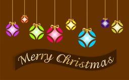 Tarjeta de Navidad adornada con las bolas coloreadas y el ` de oro de la Feliz Navidad del arco y del ` escritos en lengua ingles libre illustration