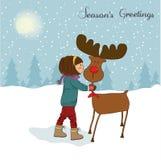 Tarjeta de Navidad con caricia linda de la niña una rienda Fotos de archivo libres de regalías