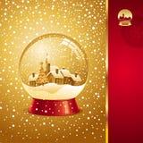 Tarjeta de Navidad con el globo de la nieve Imagenes de archivo