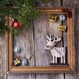 Tarjeta de Navidad con el marco del vintage Imagen de archivo libre de regalías