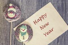 Tarjeta de Navidad con el mensaje de la Feliz Año Nuevo Fotografía de archivo libre de regalías