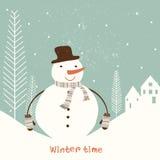 Tarjeta de Navidad con el muñeco de nieve. Foto de archivo libre de regalías