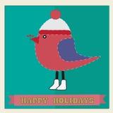 Tarjeta de Navidad con el pájaro en un casquillo Imagen de archivo libre de regalías