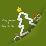 Tarjeta de Navidad con el árbol de papel doblado en su bolsillo Imagenes de archivo