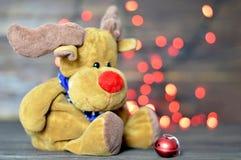 Tarjeta de Navidad con el reno de la Navidad Foto de archivo libre de regalías