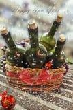 Tarjeta de Navidad con el vino y las uvas Foto de archivo