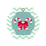 Tarjeta de Navidad con la cinta y dos bastones de caramelo Fotografía de archivo libre de regalías