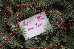 Tarjeta de Navidad con la Feliz Año Nuevo del mensaje Imágenes de archivo libres de regalías
