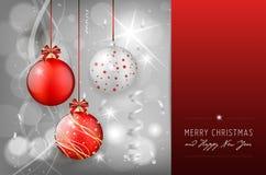 Tarjeta de Navidad con las bolas de la Navidad en fondo brillante Imagen de archivo libre de regalías