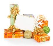 Tarjeta de Navidad con las cajas de regalo Fotografía de archivo