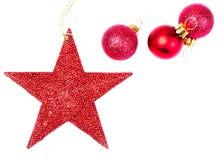 Tarjeta de Navidad con las decoraciones de la Navidad aisladas en la parte posterior del blanco Foto de archivo libre de regalías