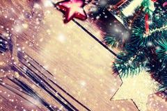 Tarjeta de Navidad con las decoraciones festivas Backdr del día de fiesta del Año Nuevo Foto de archivo