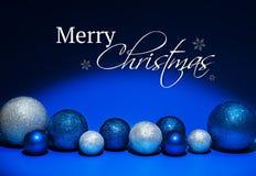 Tarjeta de Navidad con las decoraciones y el texto Foto de archivo