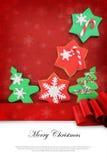 Tarjeta de Navidad con las galletas Fotos de archivo libres de regalías
