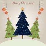 Tarjeta de Navidad con los abetos adornados Imagenes de archivo