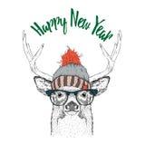Tarjeta de Navidad con los ciervos en sombrero del invierno Diseño de letras de la Feliz Navidad Ilustración del vector Imagen de archivo libre de regalías