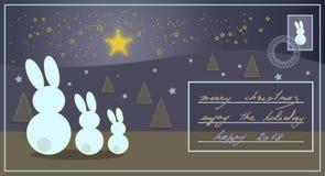 Tarjeta de Navidad con los conejos que miran las estrellas brillantes y que saludan t Fotografía de archivo