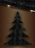 Tarjeta de Navidad con un árbol de navidad estilizado, con la sombra y la luz ilustración del vector