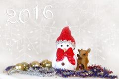 Tarjeta de Navidad con un muñeco de nieve Fotografía de archivo libre de regalías