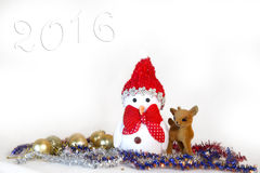 Tarjeta de Navidad con un muñeco de nieve Fotos de archivo