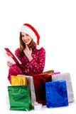 Tarjeta de Navidad de la lectura de la señora joven Imagenes de archivo