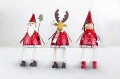 Tarjeta de Navidad de Papá Noel, de un reno y de una muchacha Imagenes de archivo