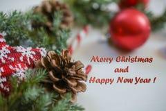 Tarjeta de Navidad del saludo con la inscripción en un marco, foto Foto de archivo