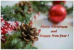 Tarjeta de Navidad del saludo con la inscripción en un marco, foto Imagen de archivo