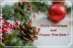 Tarjeta de Navidad del saludo con la inscripción en un marco, foto Imágenes de archivo libres de regalías