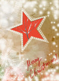 Tarjeta de Navidad del vintage con la estrella roja con los copos de nieve Imagen de archivo