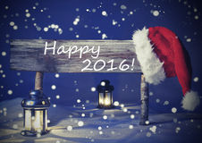 Tarjeta de Navidad del vintage con la muestra, luz de una vela, 2016 feliz Foto de archivo