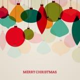 Tarjeta de Navidad del vintage con las decoraciones coloridas Fotografía de archivo libre de regalías