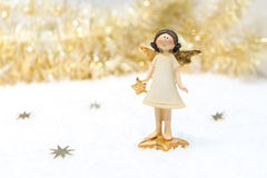 Tarjeta de Navidad en color del oro imagenes de archivo