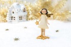 Tarjeta de Navidad en color del oro Imagen de archivo
