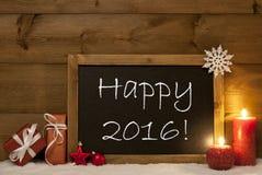 Tarjeta de Navidad festiva, pizarra, nieve, velas, 2016 feliz Imagen de archivo libre de regalías