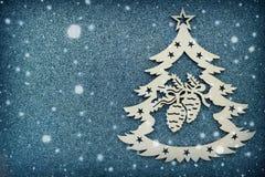 Tarjeta de Navidad hermosa, símbolo del árbol del Año Nuevo en el fondo gris, espacio vacío para su texto Imagen de archivo libre de regalías